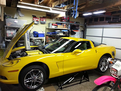 Portable Auto Lift with a Corvette in Home Garage