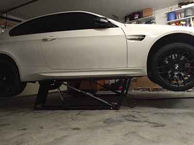 QuickJack Car Lift with Factory White Car